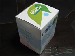 Compressed coin tissue packaging